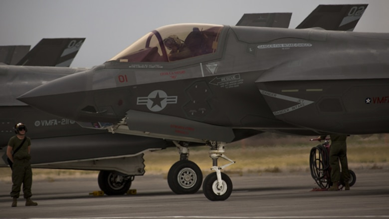 "A pilot with Marine Fighter Attack Squadron 211 ""Wake Island Avengers,"" 3rd Marine Aircraft Wing, conducts the preflight inspection of an F-35B Lightning II on the first day of Red Flag 17-3 at Nellis Air Force Base, Nev., July 10. Red Flag 17-3 is a realistic combat training exercise involving the U.S. Air Force, Army, Navy and Marine Corps and this iteration is the first to have both the Air Force's F-35A Lightning II and the Marine Corps' F-35B Lightning II, which is capable of short takeoff vertical landing."