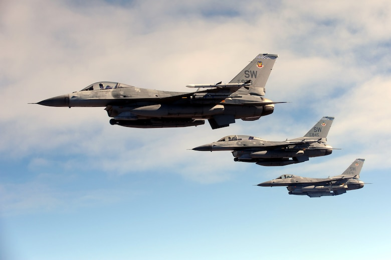 A three-ship formation of F-16CM Fighting Falcons assigned to Shaw Air Force Base, S.C., head out to the Nevada Test and Training Range for a Red Flag-Nellis 10-1 mission, in Nevada, October 2009. Team Shaw members, including maintainers, intelligence Airmen and pilots, participate in Red Flag exercises multiple times a year to maintain their combat readiness. (Courtesy Photo)