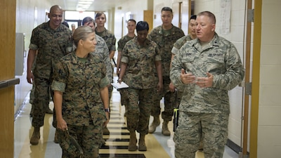 Brig. Gen. Helen G. Pratt, the commanding general of 4th Marine Logistics Group, Marine Forces Reserve, tours East Saint John High School with leaders of the Louisiana Innovative Readiness Training project in Reserve, Louisiana on July 10, 2017. This year's IRT builds mutually beneficial civil-military partnerships between local communities to provide high quality, mission-essential training for service members and their units.