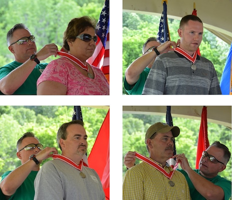 At the annual Organization Day Picnic and Awards Ceremony Colonel Secrist awarded the Steel De Fluery Medal to Sekia M. Dalton, Brandon Scott, John Johnson and Ronald S. Payne for their outstanding contributions to the Huntington District and the Engineer Regiment.