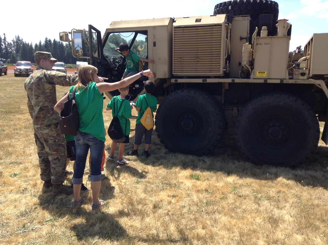 The 364th ESC along with soldiers from the 477th Transportation and 483rd Quartermaster Company provides support to the Arlington Fly-In 7-8 July, 2017, in Arlington, Wash., to promote community relations with the City of Arlington and the surrounding areas.