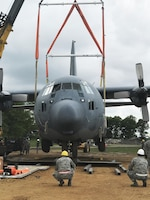 Students attempt to lift a C-130J Special Operations Aircraft that has never been lifted at the Volk Air National Guard base before. The Airmen are students of a Crash Damage or Disabled Aircraft Recover (CDDAR) training course hosted at the base on May 23. They are lifting the 84,000-pound aircraft to fulfill a training requirement for CDDAR team members. Wisconsin National Guard photo by Maj. Penny Ripperger