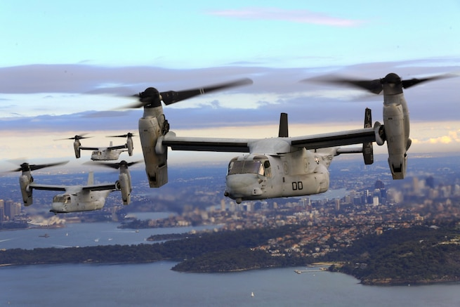 A group of MV-22B Osprey tiltrotor aircraft fly in formation above Sydney Harbor in Australia, June 29, 2017. The MV-22Bs belong to Marine Medium Tiltrotor Squadron 265.  Marine Corps photo by Staff Sgt. T. T. Parish
