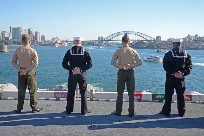 Sailors and Marines man the rails as the amphibious assault ship USS Bonhomme Richard pulls into Sydney Harbor as part of a port visit to Australia, June 29, 2017. The Bonhomme Richard was in Sydney to advance bilateral relations ahead of the training exercise Talisman Saber 17. Navy photo by Petty Officer 2nd Class Sarah Villegas
