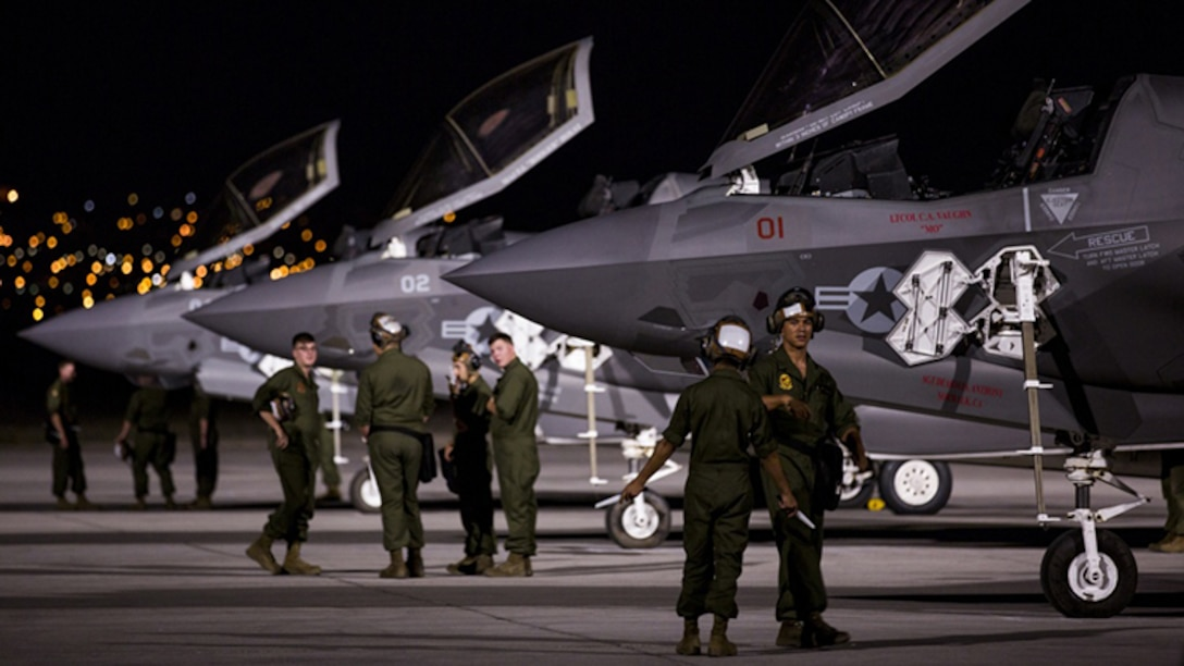 """Marines with Marine Fighter Attack Squadron 211 """"Wake Island Avengers,"""" 3rd Marine Aircraft Wing, wait for pilots to walk to three F-35B Lightning IIs on the first day of Red Flag 17-3 at Nellis Air Force Base, Nev., July 10. Red Flag 17-3 is a realistic combat training exercise involving the U.S. Air Force, Army, Navy and Marine Corps and this iteration is the first to have both the Air Force's F-35A Lightning II and the Marine Corps' F-35B Lightning II, which is capable of short takeoff vertical landing."""