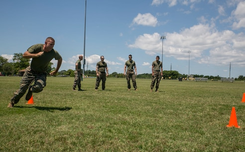 Staff Sgt. William Hobson, operations chief, G-1, U.S. Marine Corps Forces Command, sprints through the L-shaped, cone drill as part of the High Intensity Tactical Training preliminary competition at Captain Slade Cutter Park, Norfolk, Va., June 28. The competition is an annual event in which Marines compete for a shot at competing in San Diego at the national competition. (Official U.S. Marine Corps photo by Cpl. Logan Snyder/ Released)