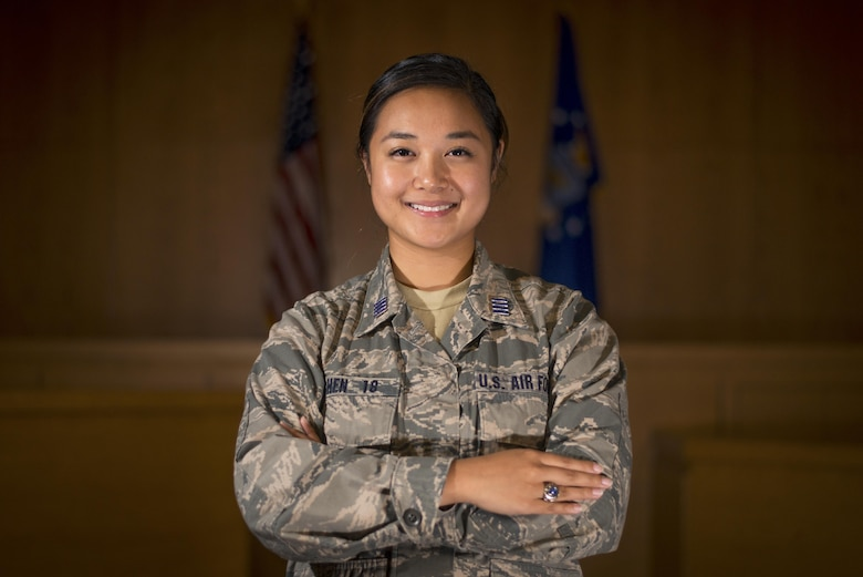 Cadet Second Class Sijia Chen, an Air Force Academy Cadet, pauses for a photo in the court room at MacDill Air Force Base, Fla., June 28, 2017. Chen, originally from China, was inspired to join the military because of the opportunities the United States has given her, and participated in a month long cadet summer research program with the 6th Air Mobility Wing Legal Office. (U.S. Air Force by Airman 1st Class Mariette Adams)