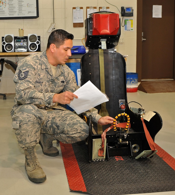 Tech. Sgt. Jonathan Sandlin, 9th Maintenance Squadron assistant section chief, reviews a checklist while inspecting a U-2 Dragon Lady ejection seat Jan. 23, 2017 at Beale Air Force Base, Calif. The ejection seat allows a pilot to quickly escape an aircraft in the event of an emergency. (U.S. Air Force photo/Airman 1st Class Tristan D. Viglianco)