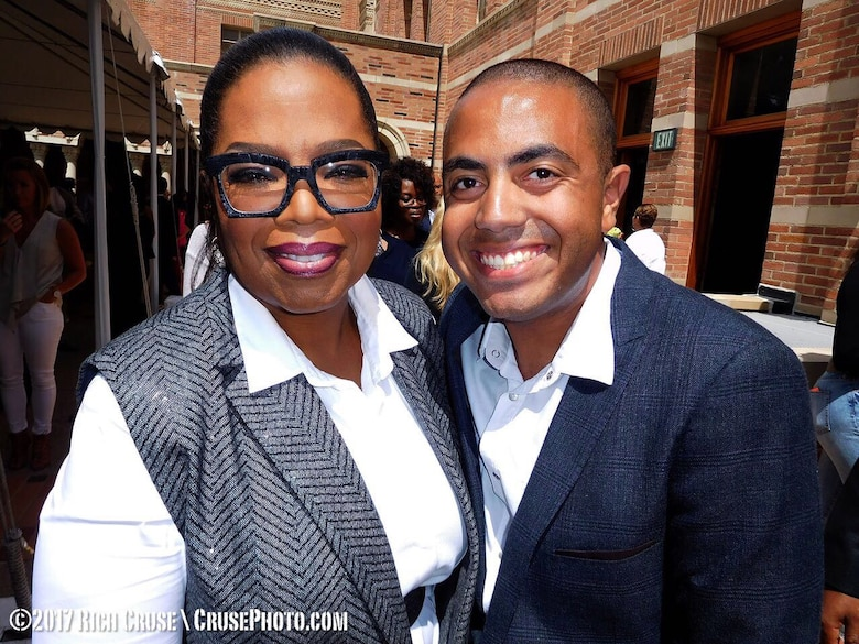 Alexander Bryant, social media strategist and graphic designer, takes a photo with Oprah Winfrey. Bryant served as an Oprah Winfrey Network ambassador. He always wanted to meet Winfrey and was able to surprise his mom, June, with meeting her as well. (Photo by Rich Cruse)