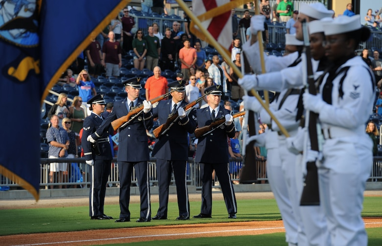 Keesler Air Force Base Honor Guard members perform a firing party during the Biloxi Shuckers Minor League Baseball team's military appreciation night July 8, 2017, in Biloxi, Miss. The Shuckers recognized and honored service members and their families for the dedication, commitment and sacrifices they make for the nation. (U.S. Air Force photo by Kemberly Groue)