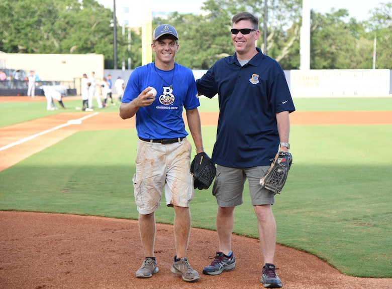 Col. C. Mike Smith, 81st Training Wing vice commander, poses for a photo with his son, Mac, during the Biloxi Shuckers Minor League Baseball team's military appreciation night July 8, 2017, in Biloxi, Miss. The Shuckers recognized and honored service members and their families for the dedication, commitment and sacrifices they make for the nation. (U.S. Air Force photo by Kemberly Groue)