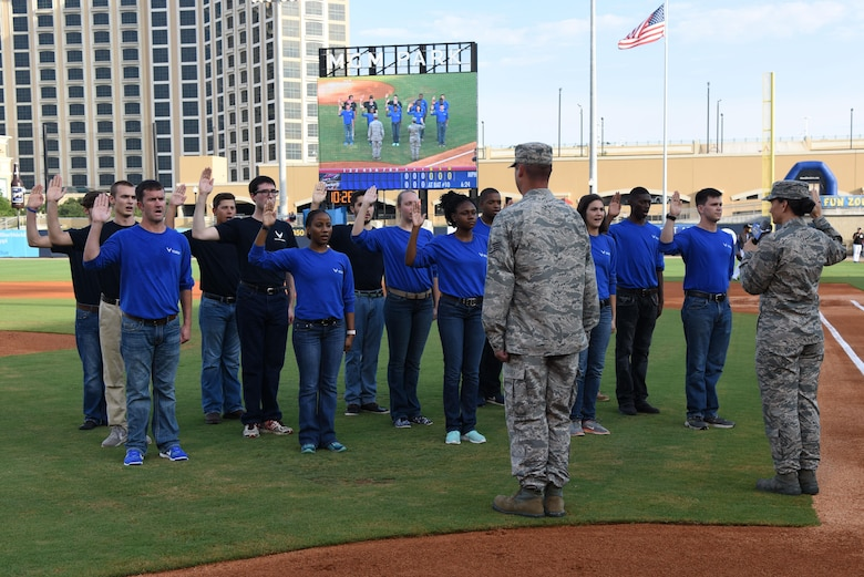 Col. Debra Lovette, 81st Training Wing commander, recites the oath of office to fifteen Air Force delayed enlistment program recruits during the Biloxi Shuckers Minor League Baseball team's military appreciation night July 8, 2017, in Biloxi, Miss. The Shuckers recognized and honored service members and their families for the dedication, commitment and sacrifices they make for the nation. (U.S. Air Force photo by Kemberly Groue)