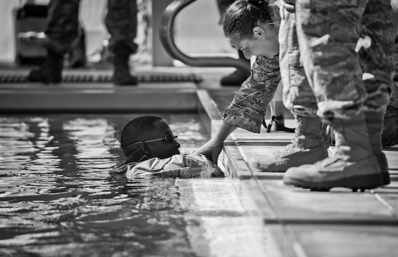 An Airman is comforted after disqualifying on the 100 meter swim portion of the German Armed Forces Badge for Military Proficiency test at Joint Base McGuire-Dix-Lakehurst, N.J., June 13, 2017. (U.S. Air National Guard photo by Master Sgt. Matt Hecht/Released)