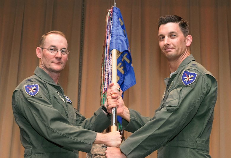 Lt. Col. Peter Hansen, right, accepts the 5th Flying Training Squadron's guidon from Col. Roger Suro, 340th Flying Training Group commander, during a change-of-command ceremony held July 7 in the Base Auditorium at Vance Air Force Base, Oklahoma. (U.S. Air Force photo/ Terry Wasson)