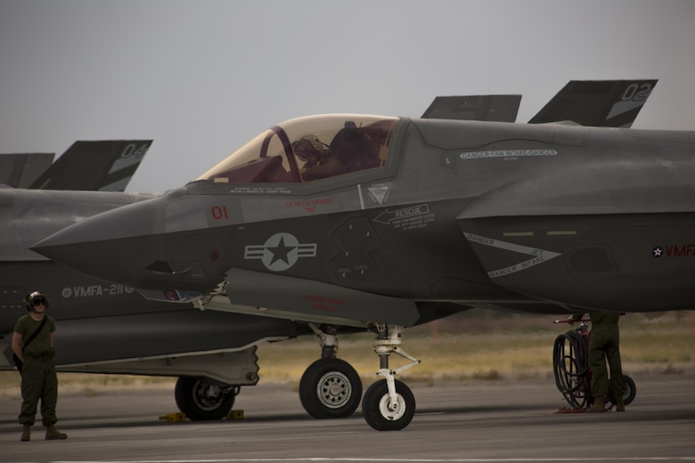 """A pilot with Marine Fighter Attack Squadron (VMFA) 211 """"Wake Island Avengers,"""" 3rd Marine Aircraft Wing, conducts the preflight inspection of an F-35B Lightning II on the first day of Red Flag 17-3 at Nellis Air Force Base, Nev., July 10. Red Flag 17-3 is a realistic combat training exercise involving the U.S. Air Force, Army, Navy and Marine Corps and this iteration is the first to have both the Air Force's F-35A Lightning II and the Marine Corps' F-35B Lightning II, which is capable of short takeoff vertical landing (STOVL). (U.S. Marine Corps photo by Sgt. Lillian Stephens/Released)"""