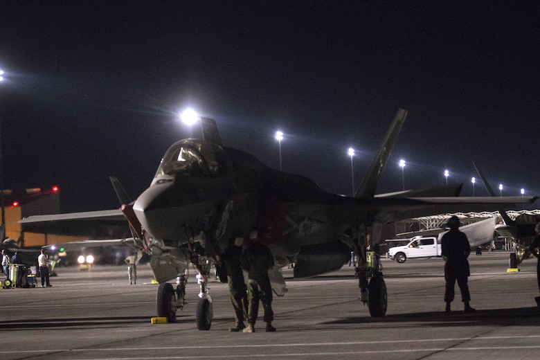 """Marines with Marine Fighter Attack Squadron (VMFA) 211 """"Wake Island Avengers,"""" 3rd Marine Aircraft Wing, prepare an F-35B Lightning II to fly on the  first day of Red Flag 17-3 at Nellis Air Force Base, Nev., July 10. Red Flag 17-3 is a realistic combat training exercise involving the U.S. Air Force, Army, Navy and Marine Corps and this iteration is the first to have both the Air Force's F-35A Lightning II and the Marine Corps' F-35B Lightning II, which is capable of short takeoff vertical landing (STOVL). (U.S. Marine Corps photo by Sgt. Lillian Stephens/Released)"""