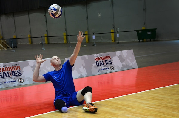 Air Force veteran Austin Williamson, a former developmental engineer officer from Louisville, Colo., serves during team volleyball practice in preparation for the 2017 Defense Department Warrior Games at McCormick Place in Chicago, June 29, 2017. Air Force photo by Staff Sgt. Alex Pons