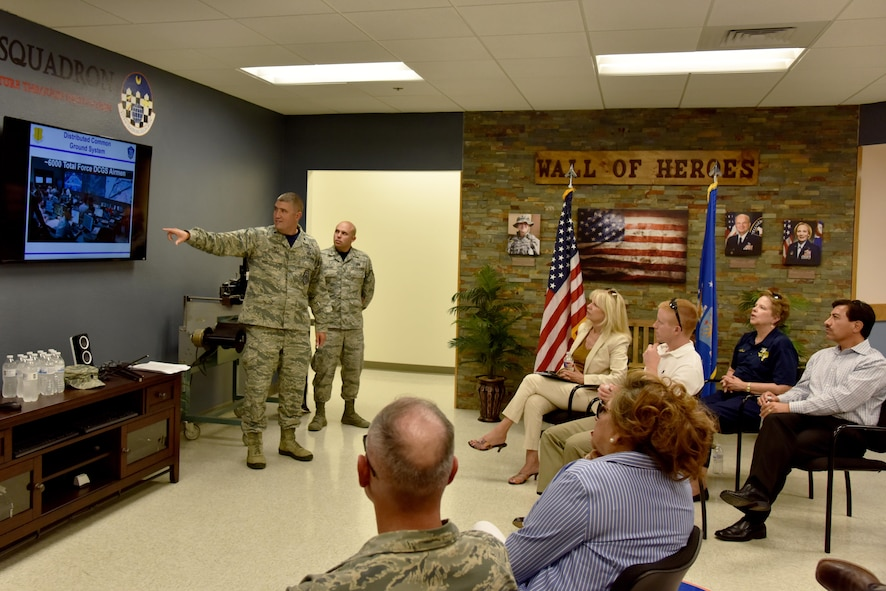 U.S. Air Force Lt. Col. Kenneth Stremmel, 315th Training Squadron Commander, briefs community leaders about intelligence training at the Di Tomasso Hall on Goodfellow Air Force Base, Texas, July 7, 2017. Stremmel and other base leaders lead a tour to help orient San Angelo, Texas community leaders to the base. (U.S. Air Force photo by Staff Sgt. Joshua Edwards/Released)