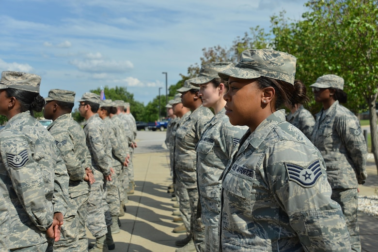 U.S. Airmen assigned to the 20th Fighter Wing (FW) stand in formation prior to a retreat ceremony at Shaw Air Force Base, S.C., June 29, 2017. The Airmen stood at attention while their wingmen in the 20th Comptroller Squadron and Wing Staff Agencies performed the retreat ceremony at the 20th FW Headquarters. (U.S. Air Force photo by Airman 1st Class Destinee Sweeney)