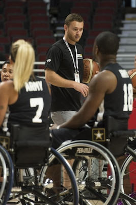 Brett Sandwick, a resilience training performance expert, works with the Army wheelchair basketball team at the 2017 Dept. of Defense Warrior Games at the United Center in Chicago, July 7, 2017. DoD photo by EJ Hersom