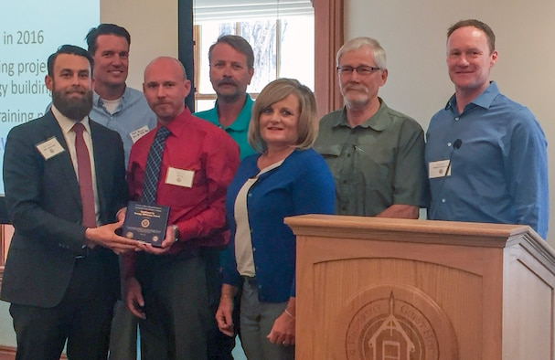 The Hill Energy Management Office accepts an award as part of the Utah Industrial Energy Efficiency Challenge. Front row from the left are Kevin Emerson, Nickolas King, and Karen Bastian. Second row from the left are Matthew Meyer, Mark Persico, Larry Hamberg, and Brian Walsh. (Courtesy photo)
