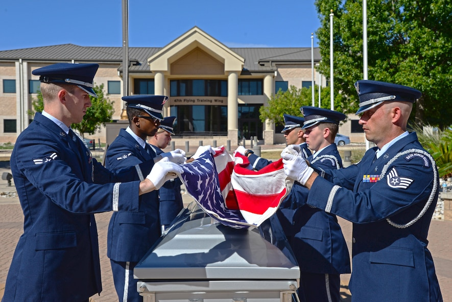 Laughlin's honor guard fold a flag during a mock funeral at Laughlin Air Force Base, Tx., July 10, 2017.  The honor guard program was formed through legislation passed by Congress in 1948. (U.S. Air Force/photo Airman 1st Class Daniel Hambor)