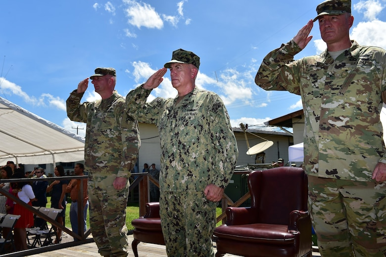 Col. Keith McKinley (left), Joint Task Force-bravo commander, Admiral Kurt Tidd (center) commander of U.S. Southern Command and Col. Brian Hughes (right), former commander of JTF-Bravo salute the formation at Soto Cano Air Base, Honduras during the Change of Command ceremony July 10th, 2017.