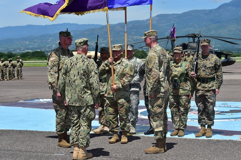 Col. Keith McKinley (left), Joint Task Force-bravo commander, Admiral Kurt Tidd (center) commander of U.S. Southern Command and Col. Brian Hughes (right), former commander of JTF-Bravo stand for the passing of the colors at Soto Cano Air Base, Honduras during the Change of Command ceremony July 10th, 2017.
