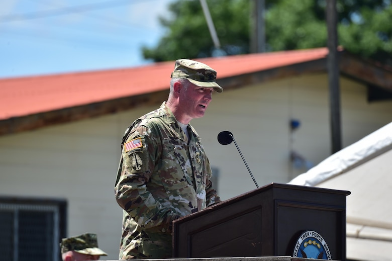 U.S. Army Col. Brian Hughes, former Joint Task force-Bravo commander, gives his closing remarks during the change of Command ceremony July 10, 2017 at Soto Cano Air Base, Honduras. Distinguished guests joined the Soldiers, Airmen and Marines to witness the passing of the colors from Col. Brian Hughes to Col. Keith McKinley as he relinquished command of the Task Force.