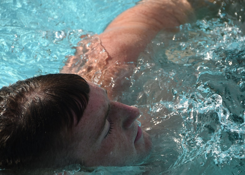 A U.S. Naval Sea Cadet Corps cadet performs the sidestroke during the swimming portion of a physical readiness test at Tyndall Air Force Base, Fla., June 25, 2017. The USNSCC is a Department of the Navy program that is designed to show young adults what the maritime services has to offer. (U.S. Air Force photo by Airman 1st Class Isaiah J. Soliz/Released)