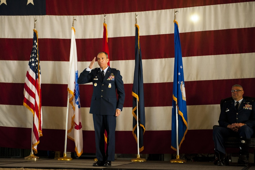 U.S. Air Force Lt. Col. Scott D. Cline, 312th Training Squadron Commander, salutes the 312th TRS for the first time during the 312th TRS change of command at the Louis F. Garland Department of Defense Fire Academy High Bay Fire Academy high bay on Goodfellow Air Force Base, Texas, July 10, 2017. The change of command ceremony is a time honored military tradition that signifies the orderly transfer of authority. (U.S. Air Force photo by Senior Airman Scott Jackson/Released)