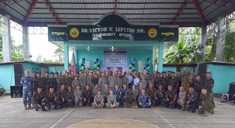 Members of Pacific Angel (PACANGEL) 2017 pose for a group photo during the closing the ceremony in Bogo City, Northern Cebu Province, Philippines, July 3, 2017. PACANGEL is a multilateral humanitarian assistance civil military engagement, which improves military-to-military partnerships in the Pacific while also providing medical health outreach, civic engineering projects and subject matter exchanges among partner forces.