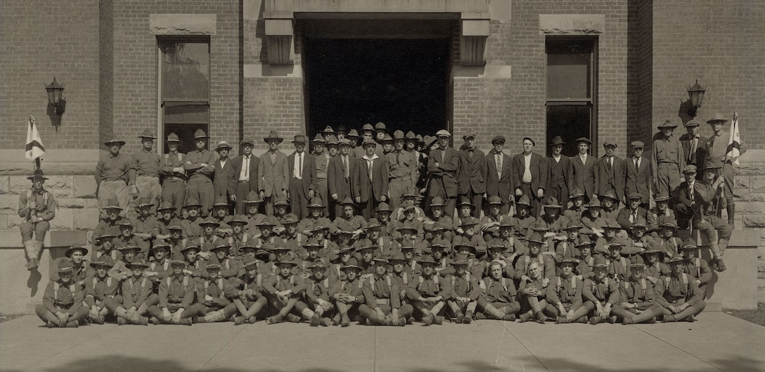 New York National Guard Soldiers assigned to Company G, 1st New York State Infantry gather outside their armory in Oneonta, N.Y. sometime in July , 1917, following their mobilization for duty in World War I. The men not in uniform were new recruits.
