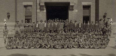 New York National Guard soldiers assigned to Company G, 1st New York State Infantry, gather outside the armory in Oneonta, N.Y., in July 1917, following their mobilization for duty in World War I. The men not in uniform were new recruits. New York State Military History Museum photo