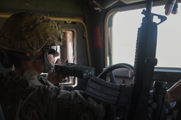 U.S. Air Force Master Sgt. Shannon Hawkins, an airfield manager deployed in support of Combined Joint Task Force – Operation Inherent Resolve and assigned to the 370th Air Expeditionary Advisory Group, Detachment 1, communicates with air traffic controllers over the radio in a Humvee at Qayyarah West Airfield, Iraq, July 2, 2017. To ensure seamless control of both Iraqi and Coalition air traffic, the U.S. Air Force's 370th supports the CJTF-OIR advise and assist mission by having a small team of air advisors at Qayyarah West airfield working alongside the Iraqis advising and assisting in day-to-day airfield operations. CJTF-OIR is the global Coalition to defeat ISIS in Iraq and Syria. (U.S. Air Force photo by Tech. Sgt. Jonathan Hehnly)