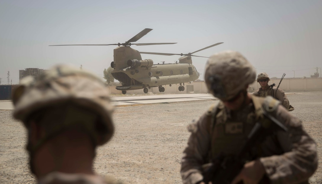 A Ch-47 Chinook lands to transport U.S. Marine advisors with Task Force Southwest after a train, advise and assist mission at the Helmand Provincial Police Headquarters in Lashkar Gah, Afghanistan, July 9, 2017. This mission provided an opportunity for advisors to meet with their counterparts, review the security posture at the PHQ and ensure that Afghan National Defense and Security Forces have an effective defense of Lashkar Gah. (U.S. Marine Corps photo by Sgt. Justin T. Updegraff)