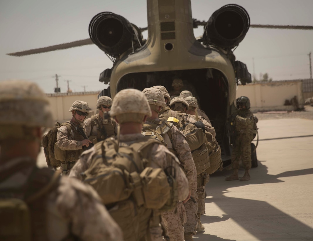 U.S. Marine advisors with Task Force Southwest embark on a CH-47 Chinook after a train, advise and assist mission at the Helmand Provincial Police Headquarters in Lashkar Gah, Afghanistan, July 9, 2017. This mission provided an opportunity for advisors to meet with their counterparts, review the security posture at the PHQ and ensure that Afghan National Defense and Security Forces have an effective defense of Lashkar Gah. (U.S. Marine Corps photo by Sgt. Justin T. Updegraff)