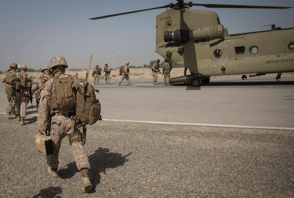 U.S. Marine advisors with Task Force Southwest load up on a CH-47 Chinook at Bost Airfield, Afghanistan, July 9, 2017. Task Force Southwest, comprised of approximately 300 Marines and Sailors from II Marine Expeditionary Force, are training, advising and assisting the Afghan National Army 215th Corps and the 505th Zone National Police. (U.S. Marine Corps photo by Sgt. Justin T. Updegraff)