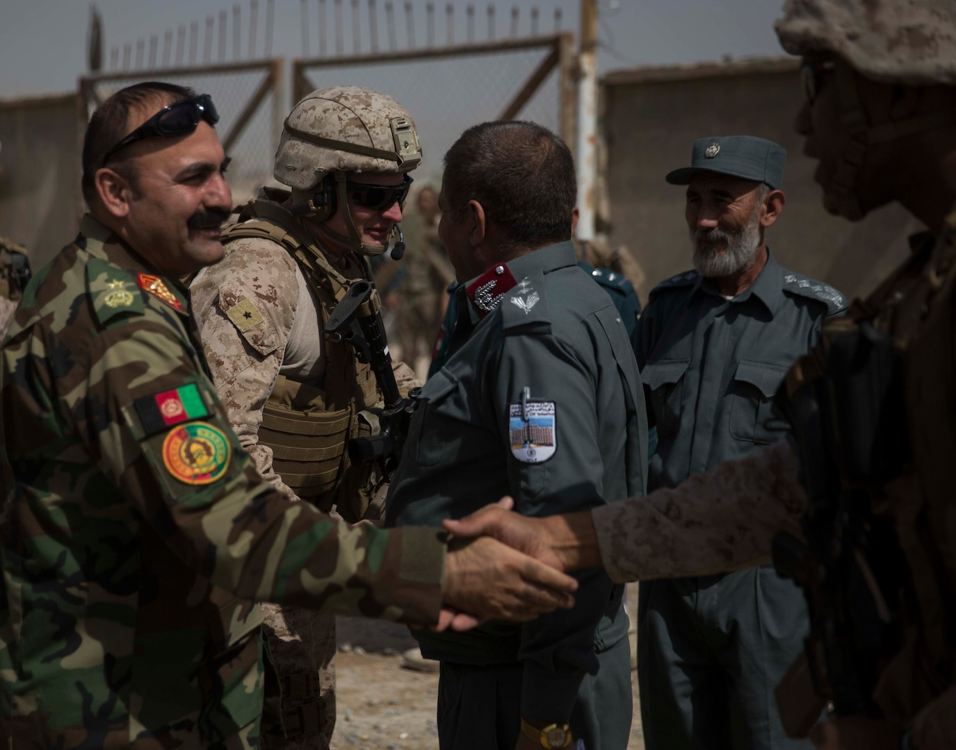 Brig. Gen Roger Turner, second from left, the commanding general of Task Force Southwest, and Col. David Gibbs, right, the commanding officer for team police, Task Force Southwest, greet their Afghan National Defense and Security Force partners after arriving at the Helmand Provincial Police Headquarters in Lashkar Gah, Afghanistan, July 9, 2017. This mission provided an opportunity for advisors to meet with their counterparts, review the security posture at the PHQ and ensure that Afghan National Defense and Security Forces have an effective defense of Lashkar Gah. (U.S. Marine Corps photo by Sgt. Justin T. Updegraff)