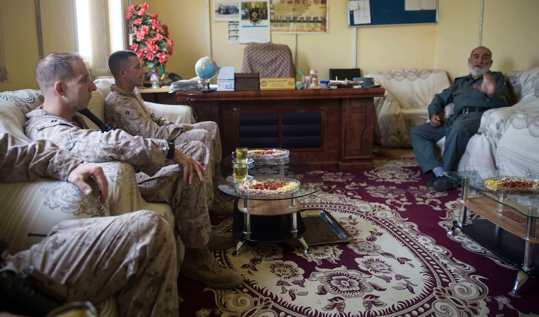 A U.S. Marine advisor with Task Force Southwest acquires information from his counterpart during a train, advise and assist mission at the Helmand Provincial Police Headquarters in Lashkar Gah, Afghanistan, July 9, 2017. This mission provided an opportunity for advisors to meet with their counterparts, review the security posture at the PHQ and ensure that Afghan National Defense and Security Forces have an effective defense of Lashkar Gah. (U.S. Marine Corps photo by Sgt. Justin T. Updegraff)