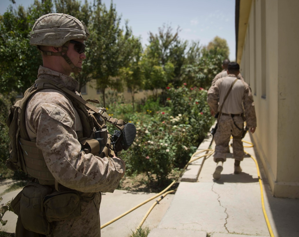 A U.S. Marine with Task Force Southwest provides security for the Marine advisors at the Helmand Provincial Police Headquarters in Lashkar Gah, Afghanistan, July 9, 2017. Task Force Southwest, comprised of approximately 300 Marines and Sailors from II Marine Expeditionary Force, are training, advising and assisting the Afghan National Army 215th Corps and the 505th Zone National Police. (U.S. Marine Corps photo by Sgt. Justin T. Updegraff)