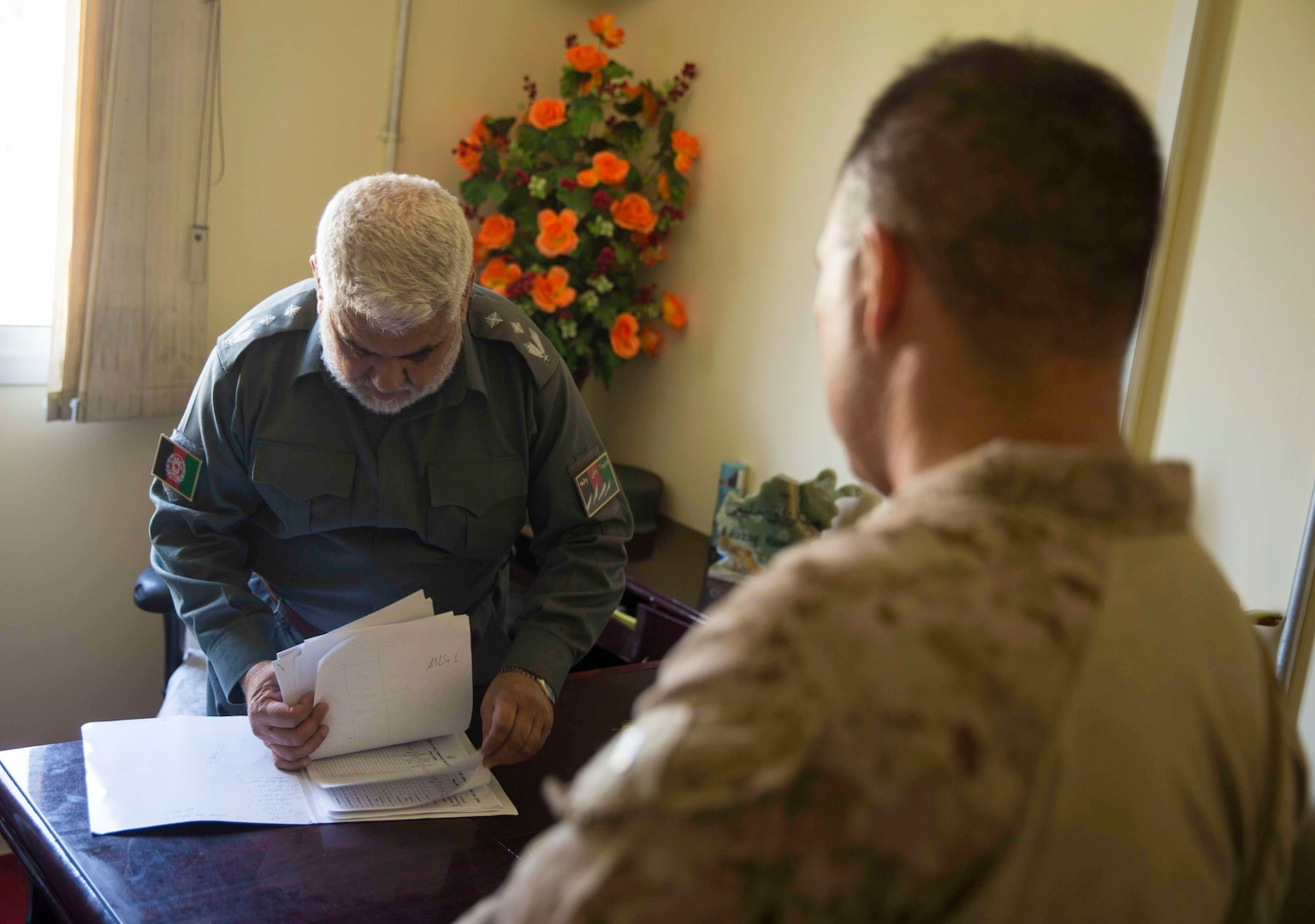 U.S. Marine advisors with Task Force Southwest speak with their counterpart during a train, advise and assist mission at the Helmand Provincial Police Headquarters in Lashkar Gah, Afghanistan, July 9, 2017. This mission provided an opportunity for advisors to meet with their counterparts, review the security posture at the PHQ and ensure that Afghan National Defense and Security Forces have an effective defense of Lashkar Gah. (U.S. Marine Corps photo by Sgt. Justin T. Updegraff)
