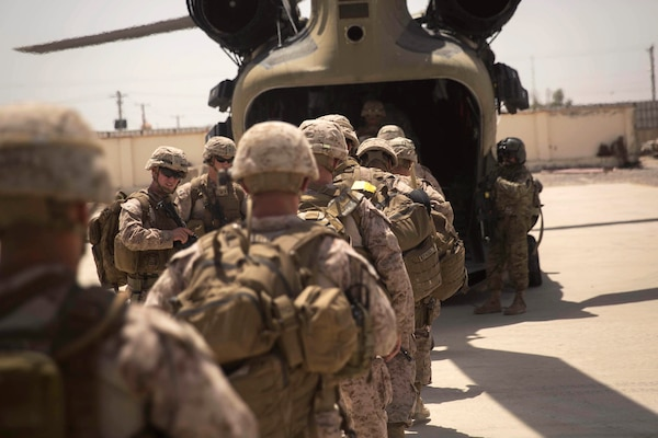 U.S. Marine advisors board a CH-47 Chinook helicopter after a train, advise and assist mission at the Helmand Provincial Police Headquarters in Lashkar Gah, Afghanistan, July 9, 2017. Marine Corps photo by Sgt. Justin T. Updegraff