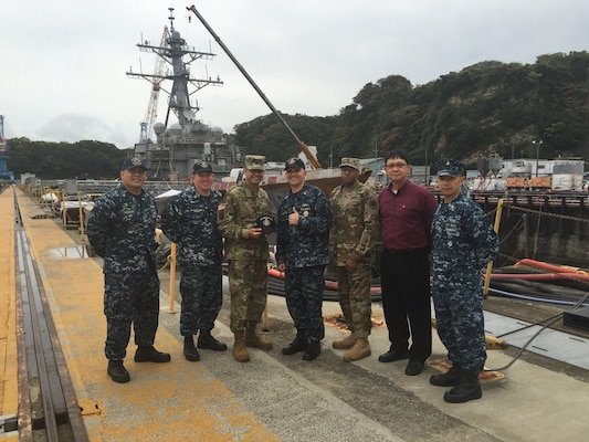 Defense Logistics Agency Senior Enlisted Leader Command Sgt. Maj. Charles Tobin, (third from left), visits with senior military and civilian leaders of the USS Blue Ridge (LCC 19) and USS John S. McCain (DDG 56) during his Nov. 9 visit to Yokosuka, Japan. Tobin visited U.S. Army and U.S. Navy customers to discuss logistics support and encourage them to provide DLA with feedback that will allow DLA to serve them better.