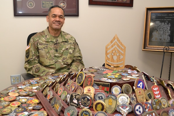 DLA Senior Enlisted Leader Command Sgt. Maj. Charles Tobin displays his collection of challenge coins.