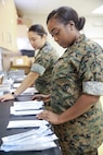 "Petty Officer 3rd Class Carlotta Howard (right) and Petty Officer 2nd Class Yani Chu (left), dental corpsmen with 4th Dental Battalion, 4th Marine Logistics Group, Marine Forces Reserve, sterilize dental tools at East St. John High School as they prepare to provide services during Innovative Readiness Training Louisiana Care 2017 in Reserve, La., July 11, 2017. The Louisiana Care Innovative Readiness Training is a joint-service medical mission that provides the military with ""hands-on"" readiness training opportunities, while at the same time providing direct and lasting benefits to the residents of Louisiana. (Photo by U.S. Marine Pvt. Samantha Schwoch/Released.)"