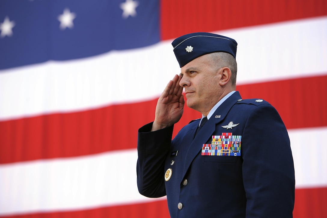 Lt. Col. Lewis Sorvillo renders his first salute to members of the 22nd Space Operations Squadron after assuming command at Schriever Air Force Base, Colorado, Thursday, July 6, 2017. 22 SOPS operates within the Air Force Satellite Control Network by developing, executing and enforcing the network operations tasking order and providing space safety analysis to conduct satellite operations. (U.S. Air Force Photo/Dennis Rogers)