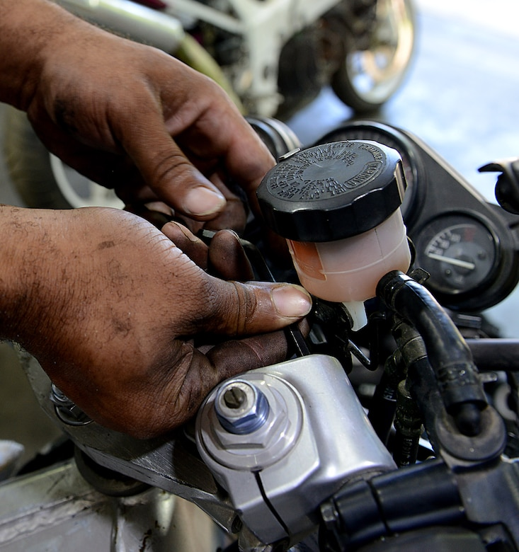 Corey Williams, Fort Eustis Auto Craft Center and Inspection Station mechanic, conducts maintenance on a motorcycle at Joint Base Langley-Eustis, Va., June 28, 2017. Williams, a former U.S. Army Soldier, was a light vehicle mechanic assigned to the 149th Transportation Company, 10th Transportation Battalion, 7th Transportation Brigade (Expeditionary). (U.S. Air Force photo/Staff Sgt. Teresa J. Cleveland)