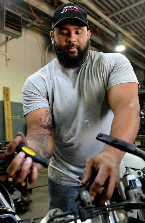 Corey Williams, Fort Eustis Auto Craft Center and Inspection Station mechanic, conducts maintenance on a motorcycle at Joint Base Langley-Eustis, Va., June 28, 2017. Williams spent eight years in the U.S. Army as a mechanic and deployed twice to Iraq before returning to the civilian sector as a mechanic at the auto center. (U.S. Air Force photo/Staff Sgt. Teresa J. Cleveland)