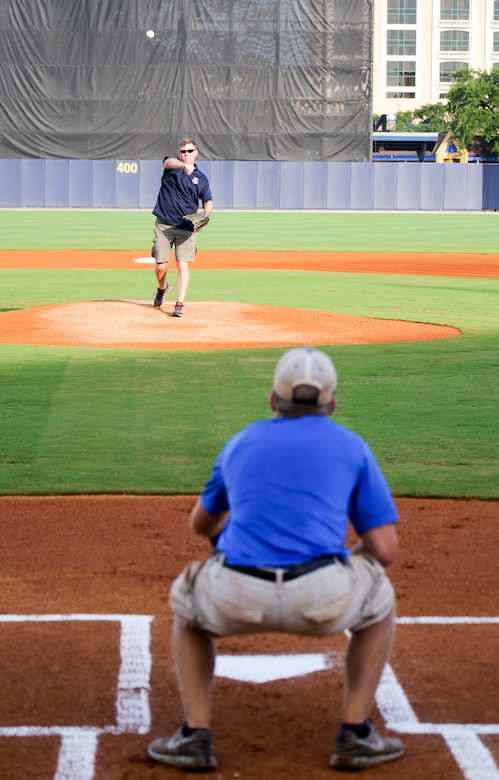 Col. C. Mike Smith, 81st Training Wing vice commander, throws the first pitch to his son, Mac, during the Biloxi Shuckers Minor League Baseball team's military appreciation night July 8, 2017, in Biloxi, Miss. The Shuckers recognized and honored service members and their families for the dedication, commitment and sacrifices they make for the nation. 
